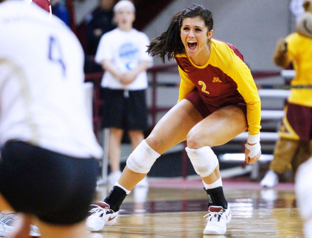 Minnesota libero Jessica Grandquist celebrates a point against Washington Saturday at the Sports Pavilion. Minnesota beat Washington in five sets and will advance to the NCAA regionals.