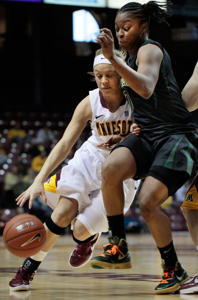 Gophers Freshman guard Rachel Banham drives past Baylor Sophomore guard Odyssey Sims Sunday at Williams Arena.  Banham scored a career-high of 19 points against the Lady Bears.