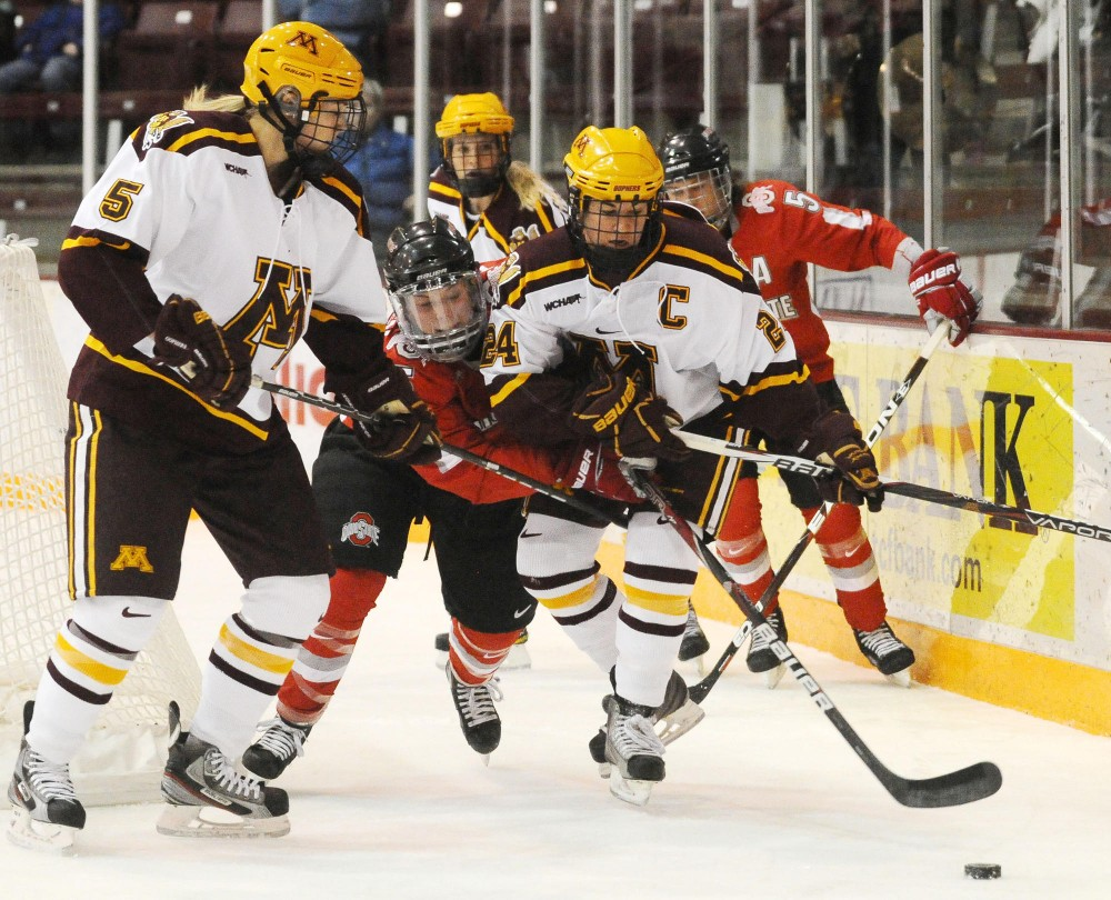 Minnesota defender Rachel Ramsey and forward Jen Schoullis fight fight for the puck against Ohio State on Saturday afternoon at Ridder Arena. The Gophers claimed victory 4-1.