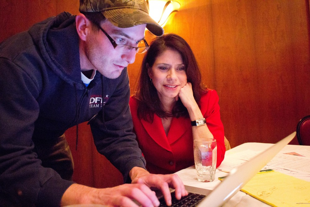 DFL primary winner Kari Dziedzic and campaign volunteer Jason Metsa update her Facebook status Tuesday following the announcement of her victory at Dziedzics election party at Jax Cafe in Minneapolis.