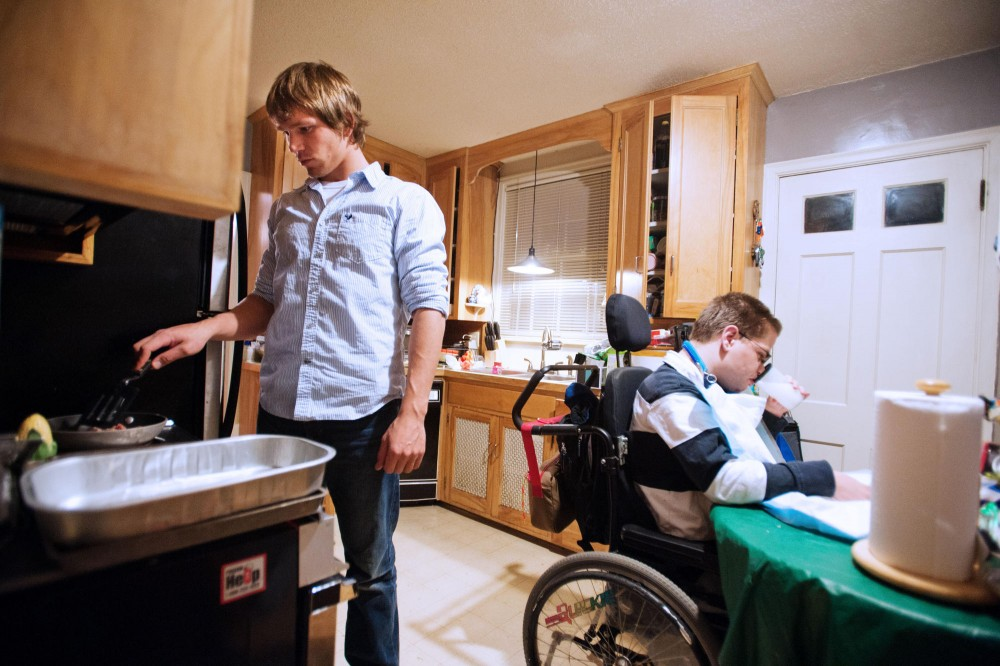 Anthropology junior Tim Clemens prepares dinner, a gluten-free casein-free pizza, for Aaron Wager on Monday at Wager's home in Minneapolis. Wager is currently on a gluten-free casein-free diet.