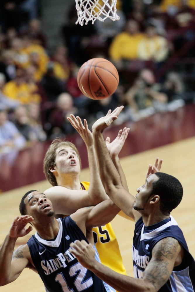 Minnesota center Elliott Eliason fights for a rebound against St. Peter on Saturday afternoon at Williams Arena.
