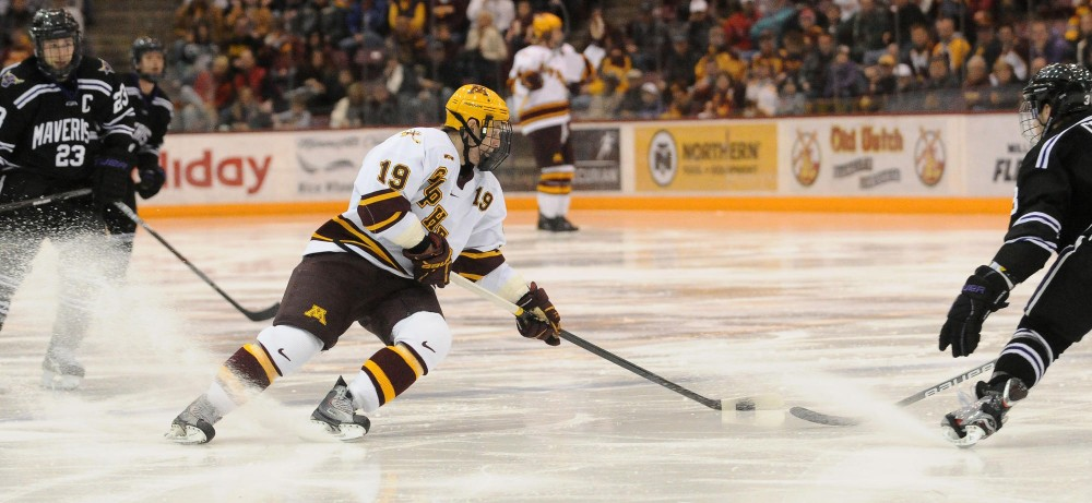 Erik Haula handles the puck against Minnesota State during Saturday night's game in Maricucci Arena.  The Gophers swept MNSU during the weekend series with a total of 7 goals.