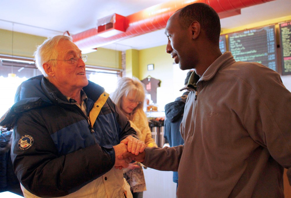 Northeast Minneapolis resident Mike Ross shakes hands with former SD59 candidate Mohamud Noor Saturday at the Coffee Shop Northeast.
