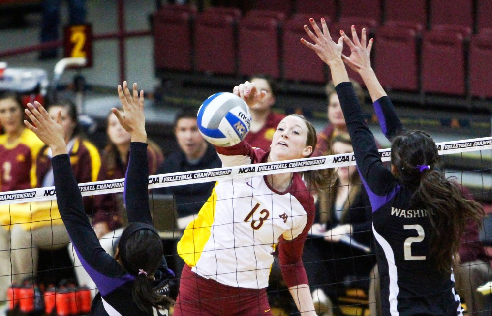 Outside hitter Ashley Wittman spikes the ball past Washington Saturday at the Sports Pavilion. Minnesota beat Washington in five sets and will advance to the NCAA regionals.