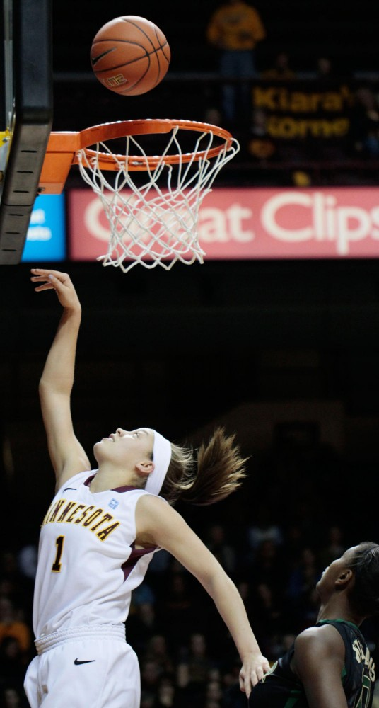 Minnesota guard Rachel Banham goes up for a basket against Baylor on Sunday at Williams Arena.