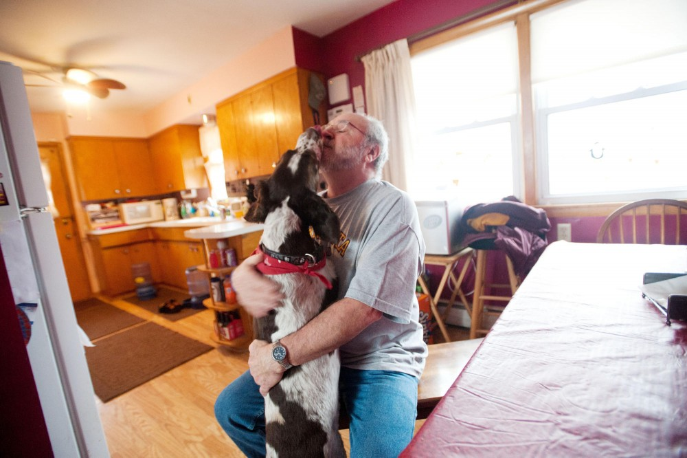 Luke jumps up to his owner, Mike Huston, and gives him a kiss Saturday at home in Crystal, Minn.