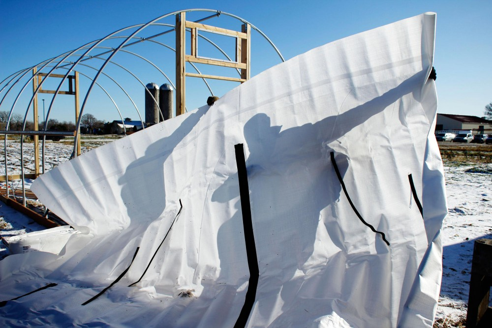 Volunteers worked to construct a high tunnel Friday on the St. Paul campus.