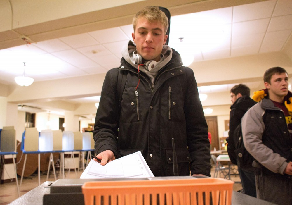 Sophomore finance and risk management major Tommy Koehn submits his ballot for the DFL primary Tuesday at the Grace University Lutheran Church in Minneapolis.