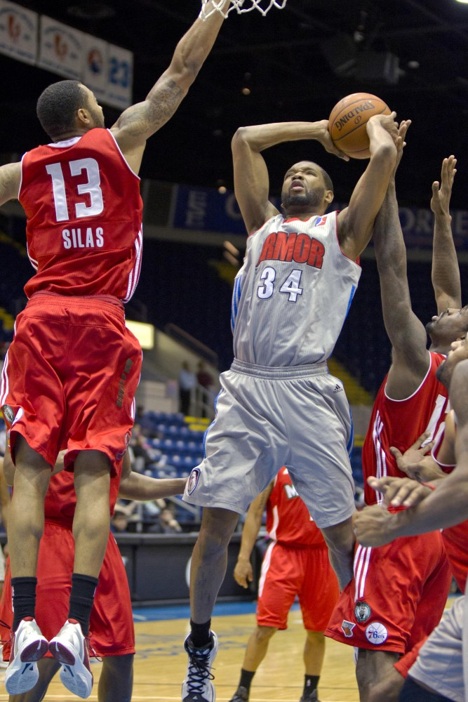 Former Gophers' basketball player Damian Johnson elevates with the ball as the Maine Red Claws' Xavier Silas attempts to block his shot. Johnson has played for the Springfield Armor since early January.