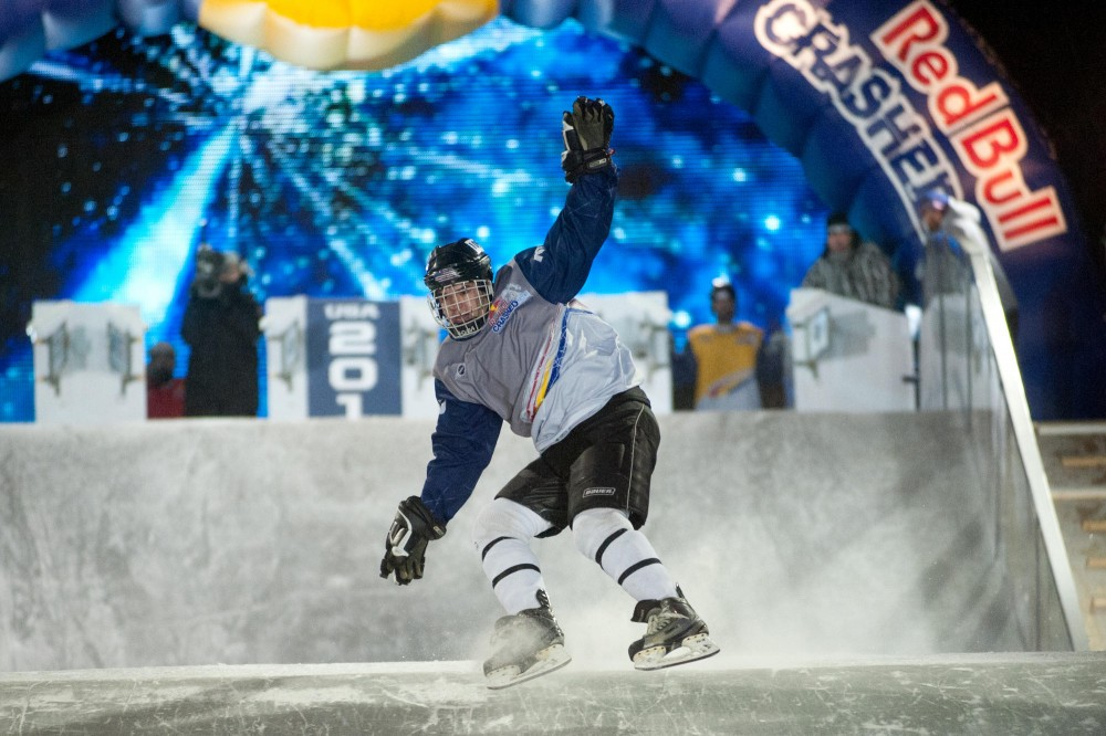University of Minnesota journalism junior Mike Slator falls at the start of an elimination round during the Red Bull Crashed Ice World Championship on Friday in St. Paul.