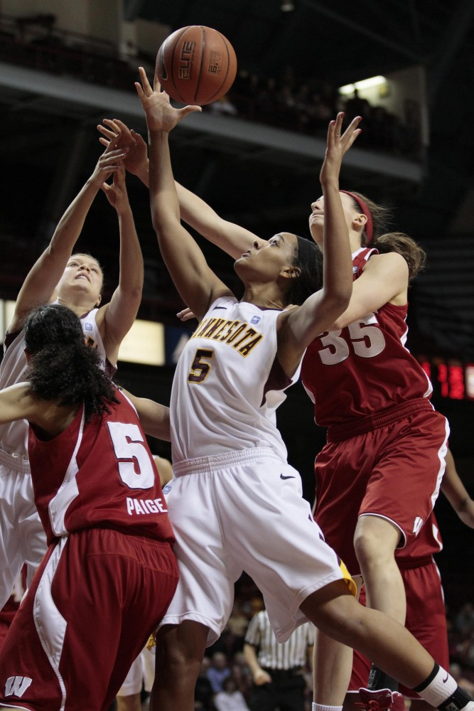 Kionna Kellogg goes up for the rebound against the Wisoncon Badgers Thursday night in Williams Arena.