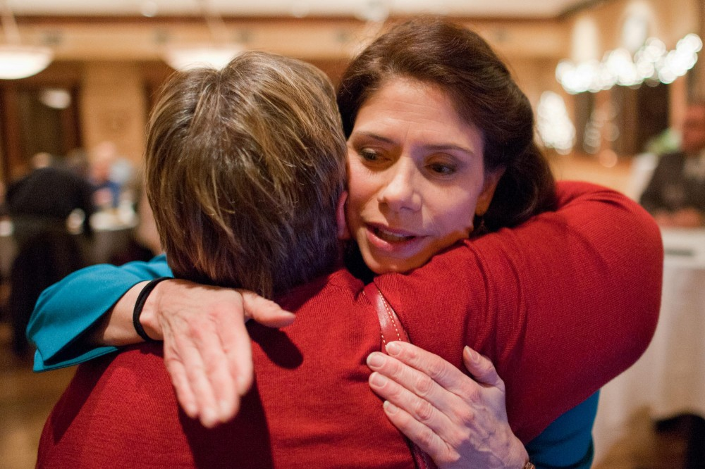 Senator-elect Kari Dziedzic hugs Senator Linda Higgins at her election night party Tuesday at Elsie's Restaurant in Minneapolis. Dziedzic won the special election for Senate District 59 with 79 percent of the vote.