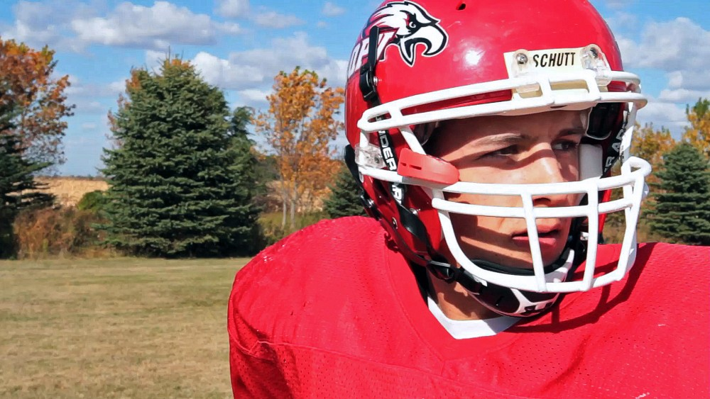 Lac qui Parle Valley High School senior Ryan Bergerson waits for the snap during football practice Sept. 29 in Madison, Minn.  Bergerson played cornerback and tight end for his varsity football team and plans to play intramural sports at the University of Minnesota if he decides to go there.
