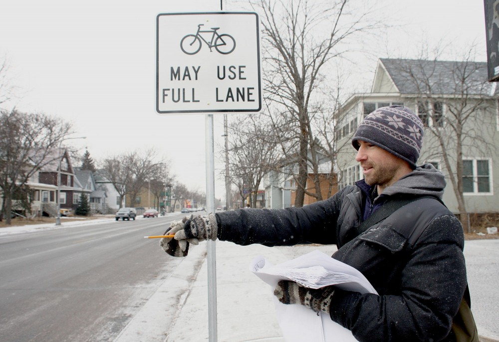 Minneapolis Bicycle and Pedestrian Coordinator Shaun Murphy surveys the Como neighborhood Saturday to verify new bike traffic signs implemented. The new position will work to streamline different transportation needs of Minneapolis communities.