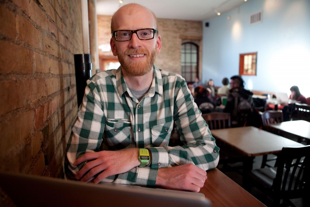U of M graduate and web developer Zachary Johnson poses for a photo at Common Roots Cafe in Minneapolis Thursday afternoon. Johnson created a code for the SOPA/ PIPA protests that allows people to use it to black out their websites.