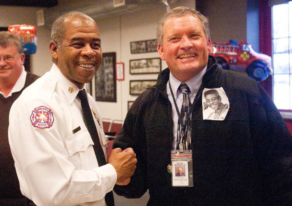 Minneapolis fire chief Alex Jackson shakes hands with his successor, John Freutel, at Jackson's retirement party Friday afternoon at the Bill and Bonnie Fire Museum in north east Minneapolis.