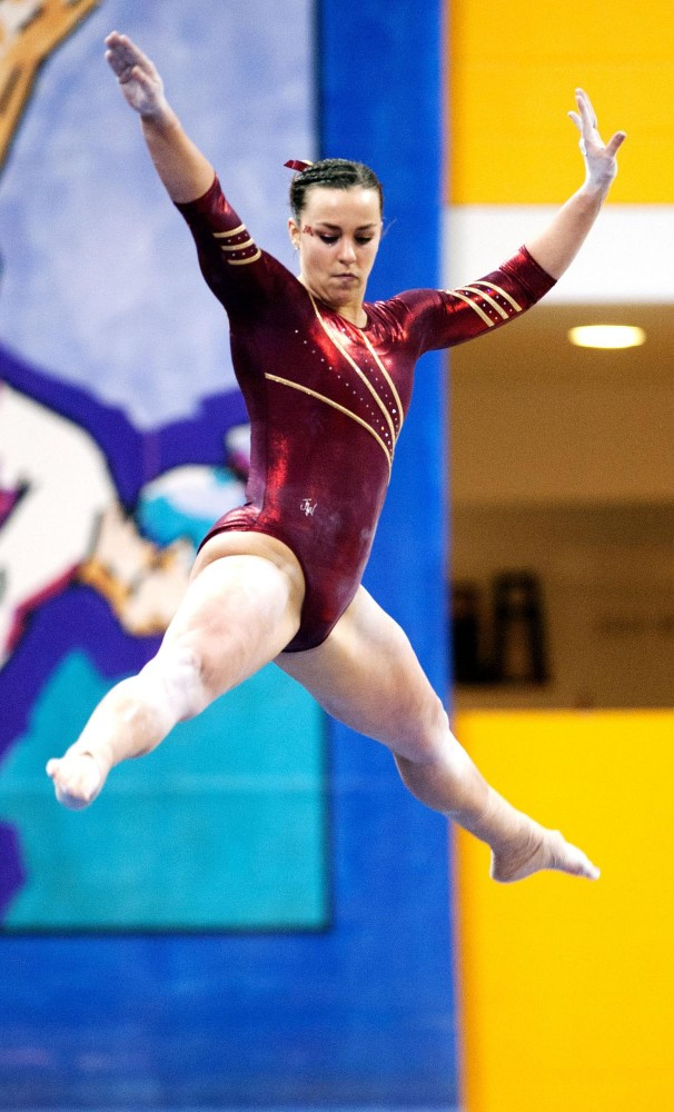 Gophers sophmore Kayla Slechta in action on the balance beam Saturday night at Sports Pavilion.