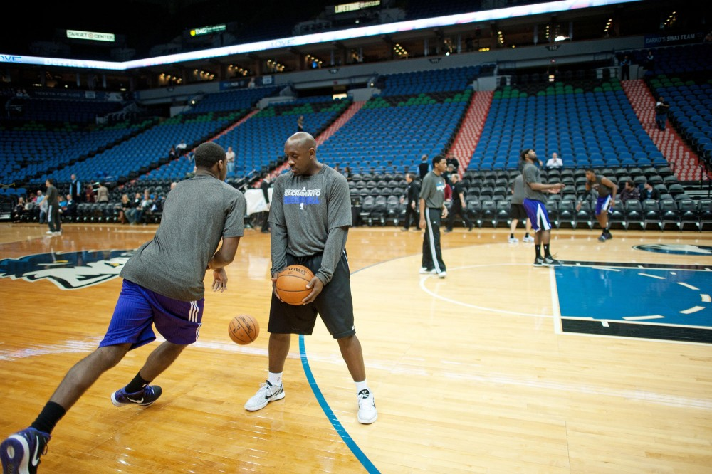 Former gopher basketball player Bobby Jackson helps Sacramento Kings' players to warm up before a game Monday at Target Center. Jackson started working as an assistant coach for the Kings last November.