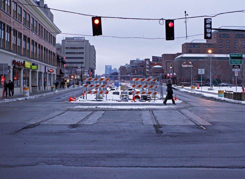 Light rail construction in the intersection of Oak Street and Washington Avenue was supposed to be completed in November.
