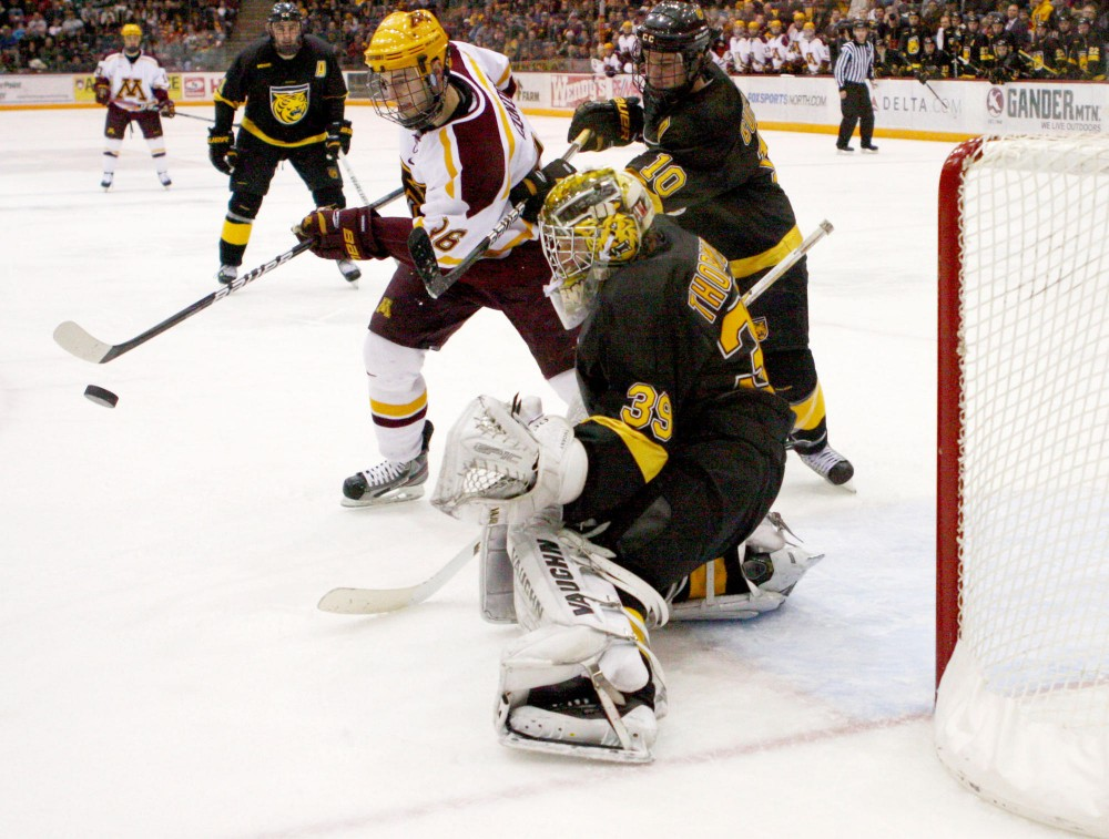 Minnesota forward Christian Isackson attempts a goal against Colorado College Saturday night at Mariucci Arena. Minnesota won the game 2-1.