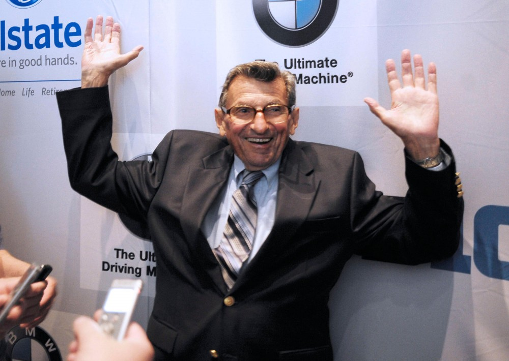 Penn State Head Coach Joe Paterno talks with reporters July 28, 2011 at Big Ten Media Days in Chicago.