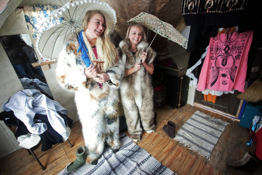 Elisabeth Stengaardsbakken and friend Kimmie Thelen pose for a photo inside Sashy Shanty Saturday morning on Medicin Lake. The art shanties are part of a four week exhibition inspired by the ice fishing house that are a tradition on frozen lakes.