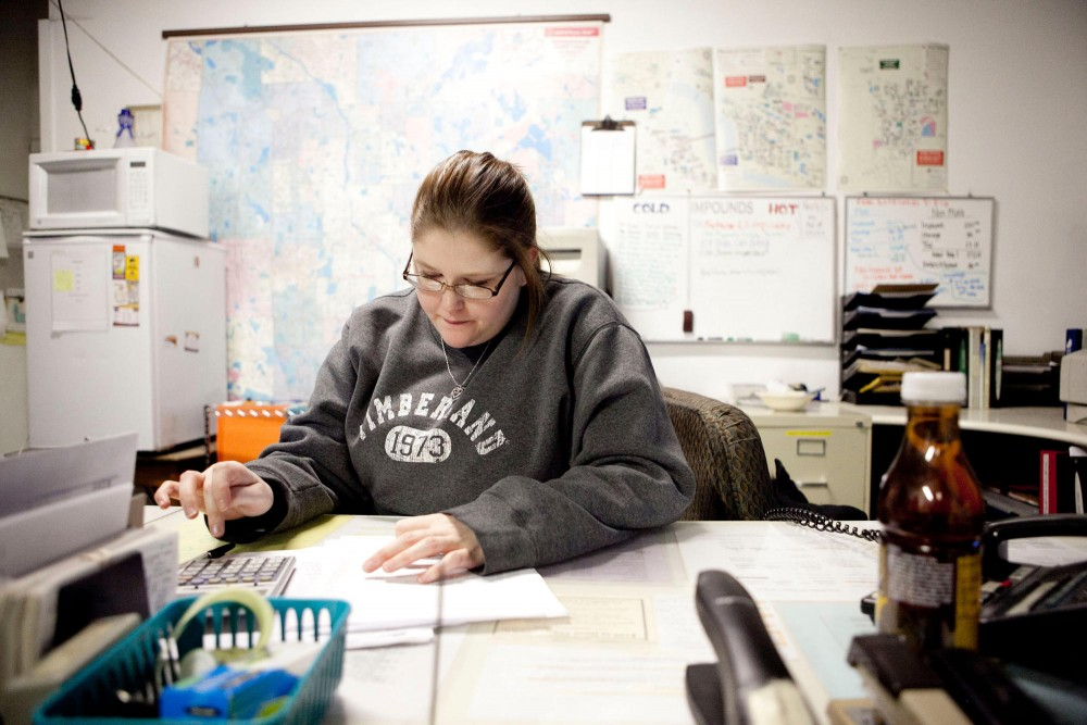 Office Manager April Reichert balances the books Monday evening at Gopher Towing. According to owner Jene Buell they've only made ten percent of what they made last winter.