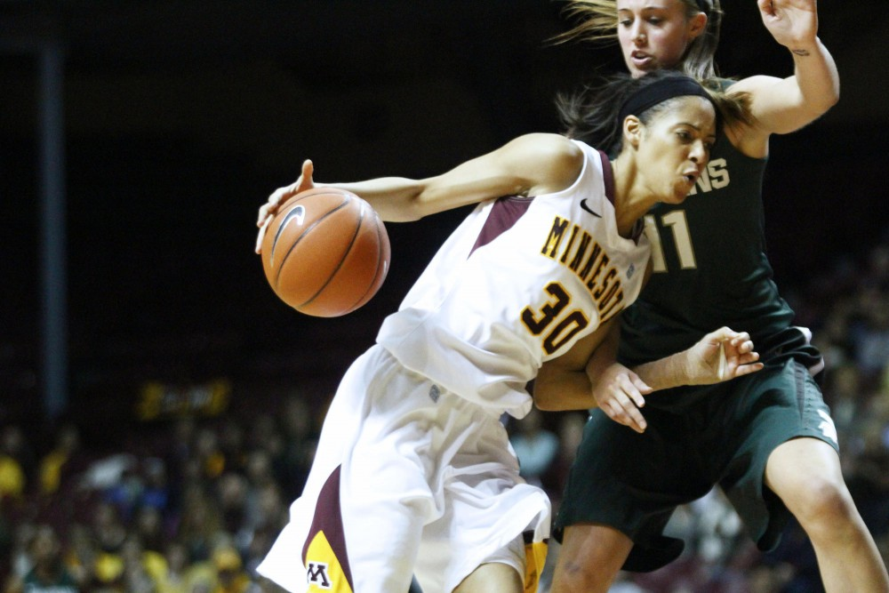 Minnesota guard Kiara Buford charged past Michigan forward Annalize Pickrel Thursday night at Williams Arena. Minnesota won 71-65 with Buford scoring 22 points of the game.
