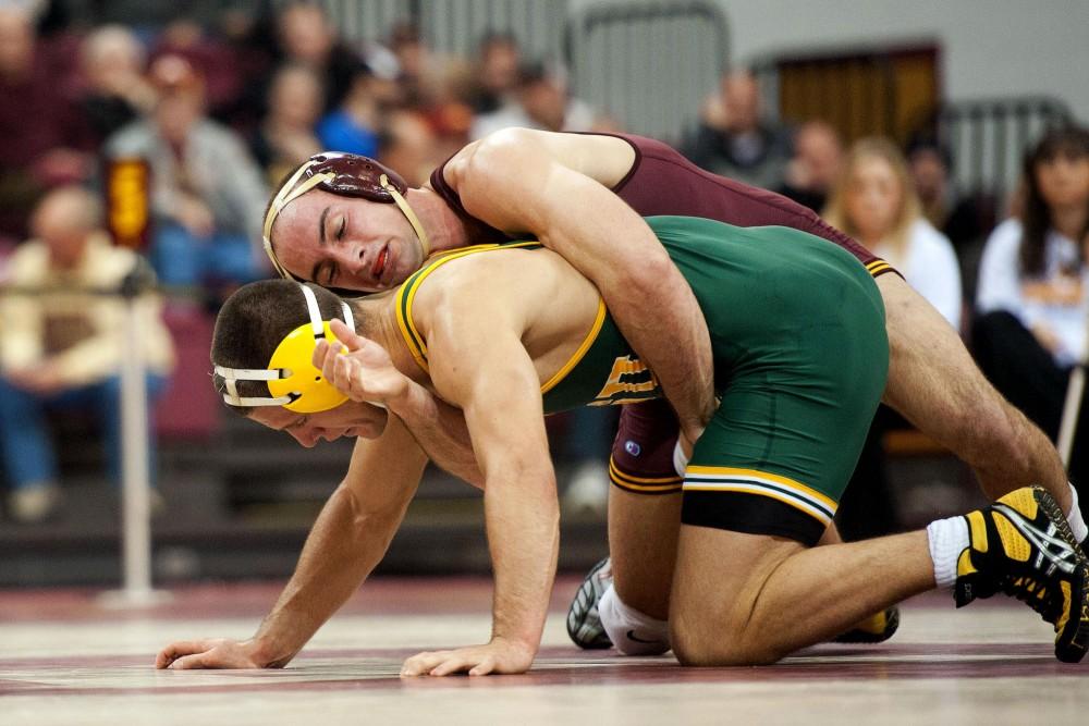 Cody Yohn (165) wrestles against North Dakota State on Nov. 27.