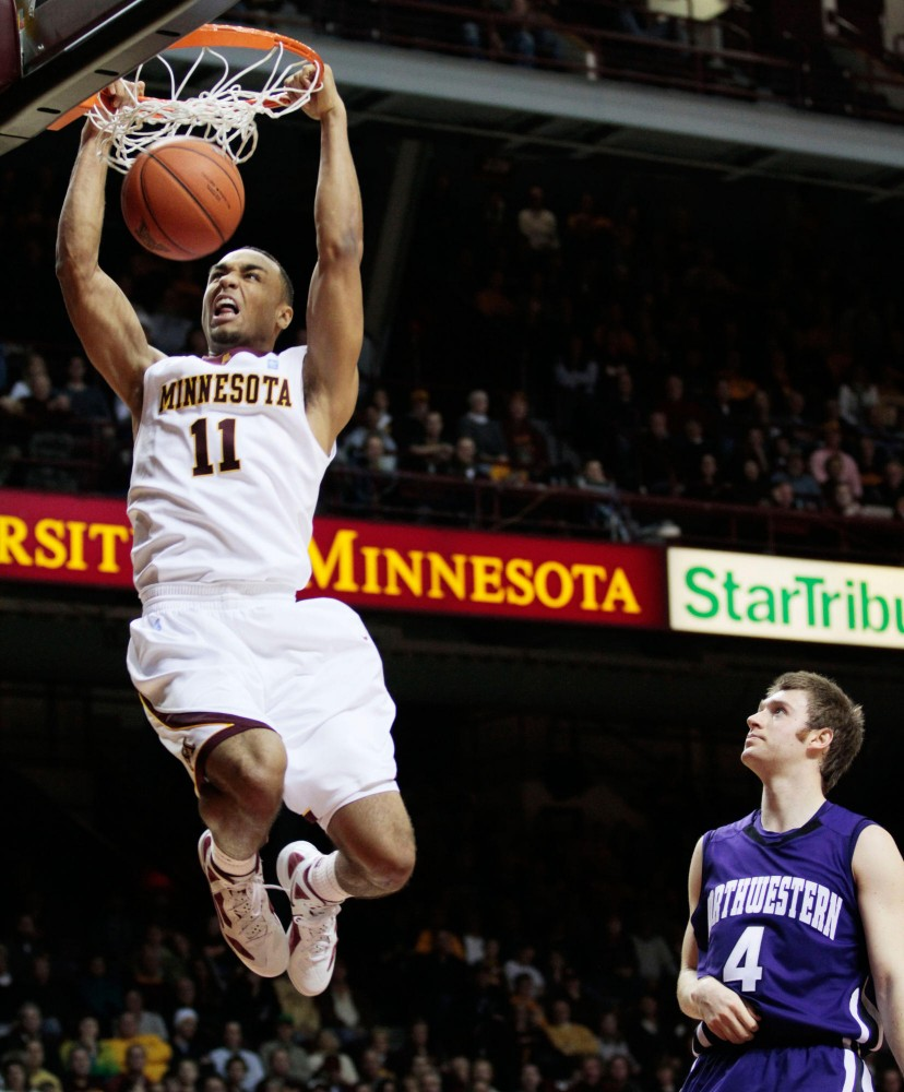 Minnesota guard Joe Coleman dunks the ball against Northwestern on Sunday at Williams Arena.