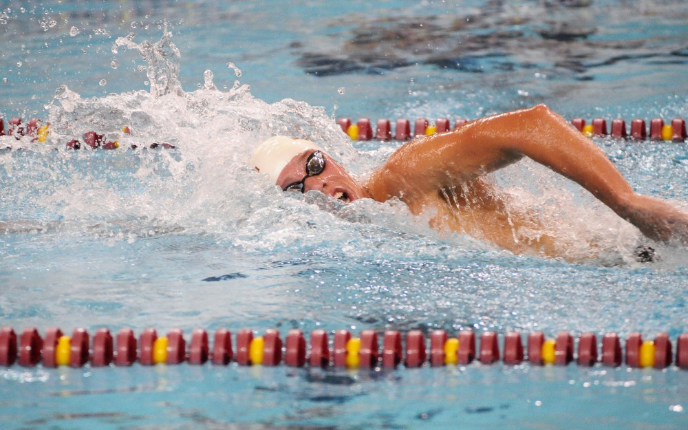 Freshman CJ Smith leads the pack in the 1,000-meter freestyle at the University Aquatic Center on Friday night.  Smith took first-place with a time of 9:10.25.