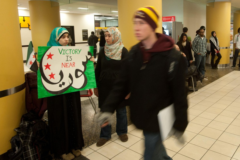 An Syrian Augsburg student demonstrates in support of the opposition movement in Syria on Friday in Coffman Union.