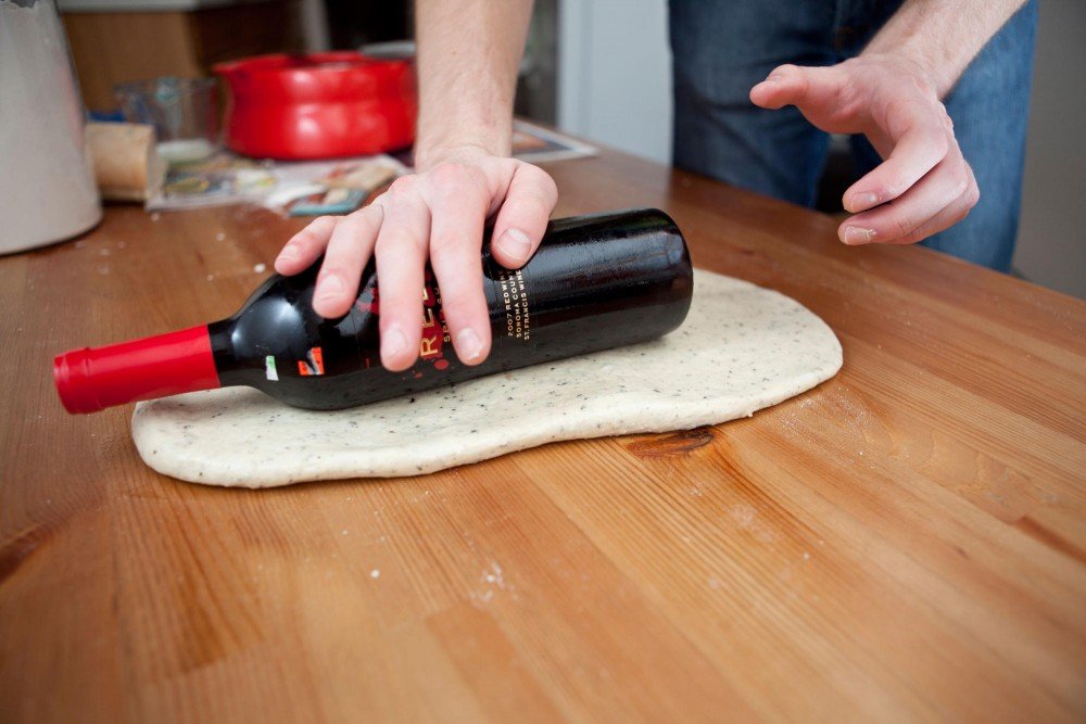 The trick to getting the loaf shape is to roll the dough flat and fold it into itself.  Substitutes like using a wine bottle can be made when normal utensils aren't available.