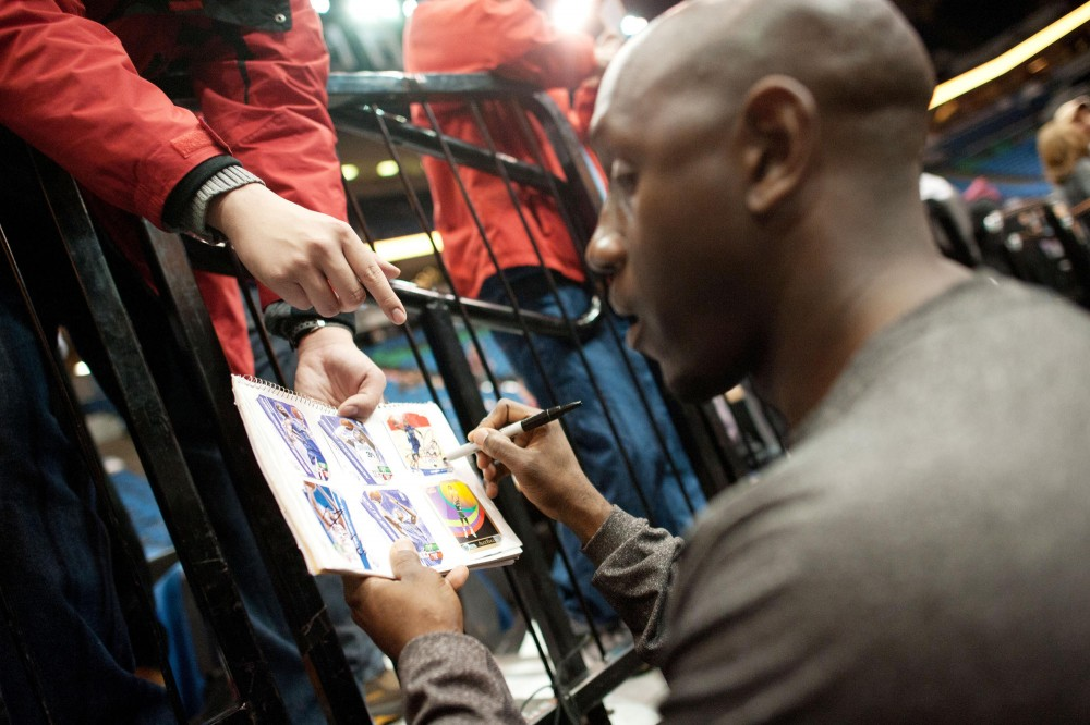 Bobby Jackson signs his autographs for fans before a game Monday at Target Center.