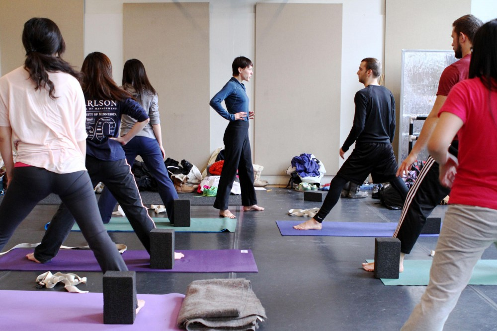 Yoga instructor Christine Ojala, center, teaches the Universitys only for-credit yoga class. Ojala had to turn away many students from the class to keep the size manageable for instruction.