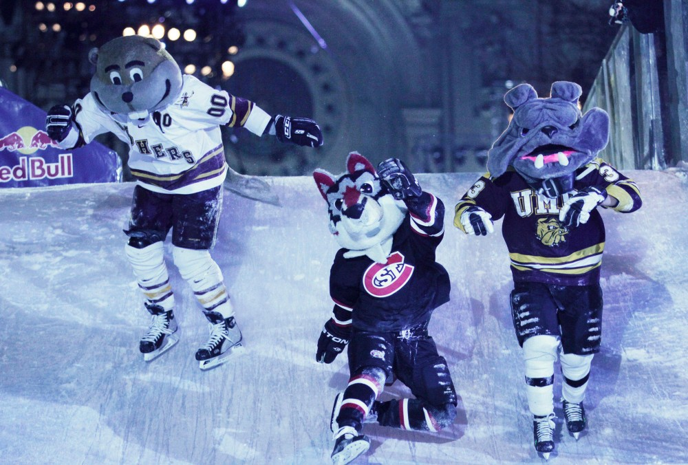 Gophers, Huskies, and Bulldogs mascots race for the finish Saturday evening at the Red Bull Crashed Ice event in St. Paul.