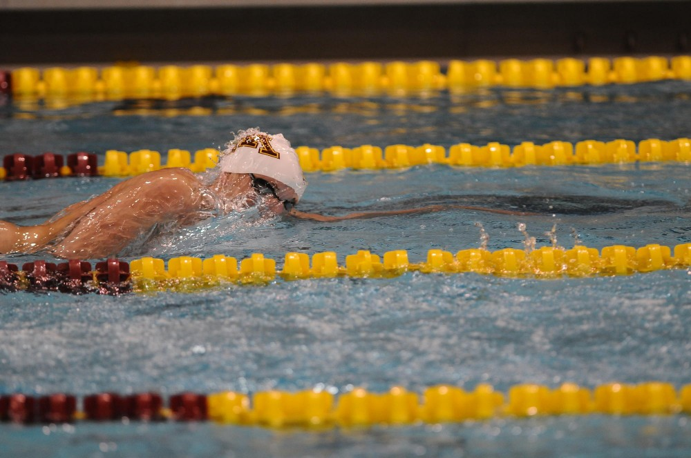 Minnesota Freshman Garin Marlow races in the 500-meter freestyle at the Aquatic Center on Friday night.  Marlow took 3rd in the 500 with a time of 4:33.08.