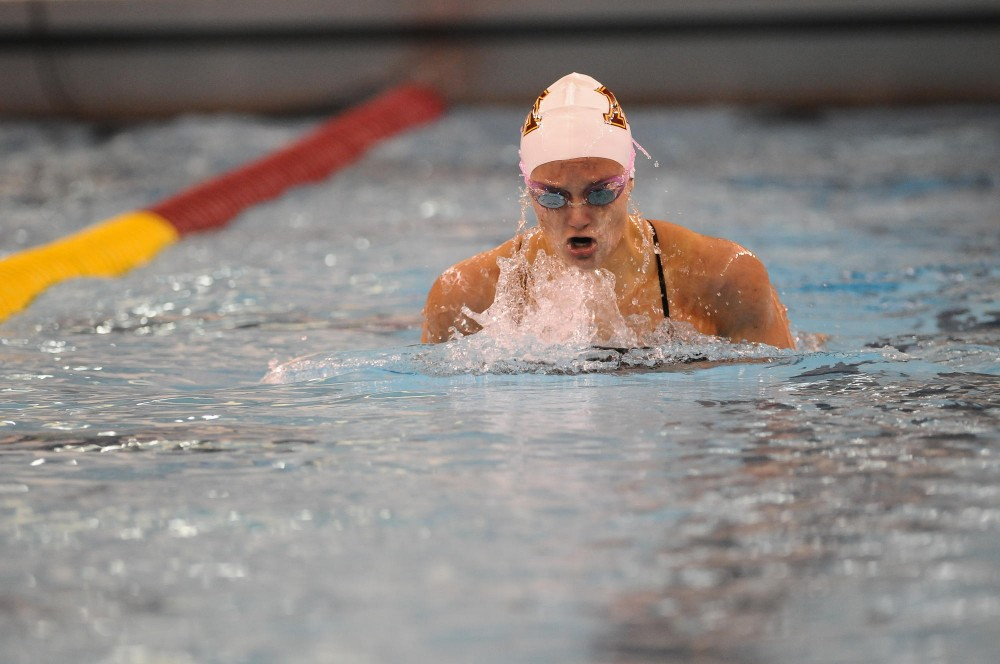 Minnesota Freshman Tori Simenec surfaces during the 200-meter individual medley at the Aquatic Center on Friday night.  Simenec took first place in the 200 IM with a time of 2:01.40.
