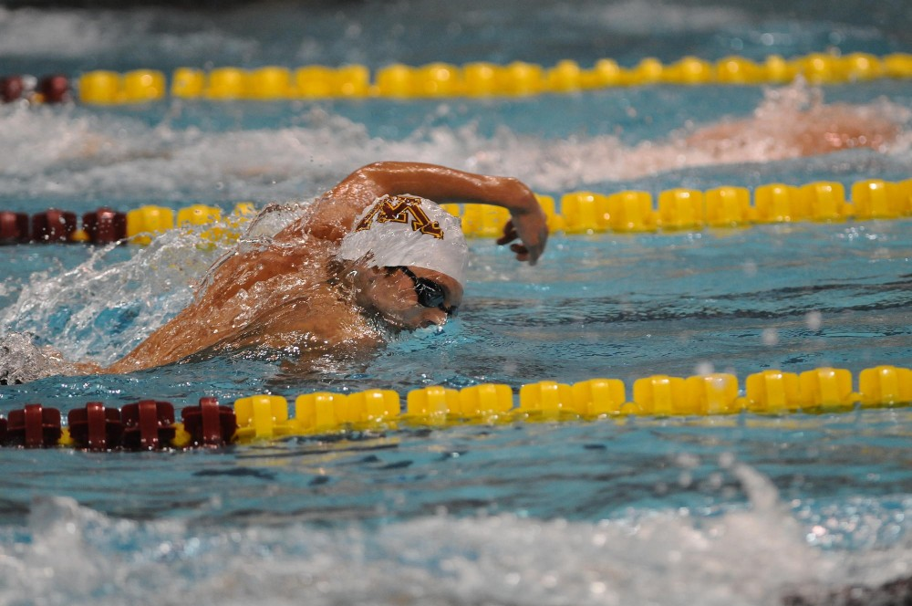 Minnesota Freshman Alex Cisnerosraces during the 500-meter freestyle at the Aquatic Center on Friday night.  Cisneros took 6th place in the 500 with a time of 4:37:04.