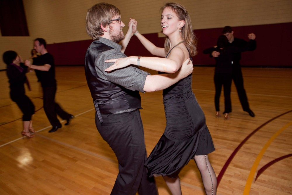 Brian Folger dances with Paige Sandness during competition team practice in the ballroom dance club Friday evening in Bierman gym.