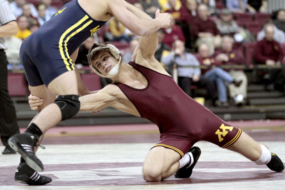 Gophers Dylan Ness attempts to take down Michigans Eric Grajales Jan. 27 at the Sports Pavilion.