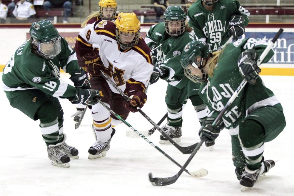 Minnesota forward Sarah Davis fights for the puck against Bemidji State on Jan. 20 at Ridder Arena.