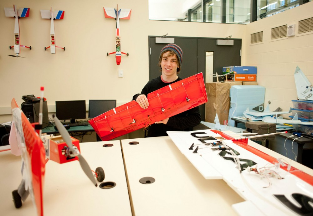 Electrical engineering senior James Rosenthal works on research aircraft Sunday afternoon in Akerman Hall. The planes are assembled as kits then modified with electronics and sensors. Some of the sensors he uses are supplied by NASA.