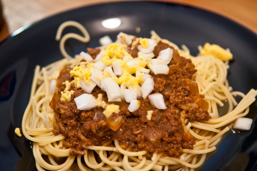Spaghetti noodles and onions help differentiate Cincinnati Chili from its less Ohio-born sibling.