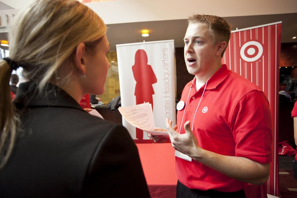 Target representative Kirk Ingram talks with mechanical engineering student Kristen Huber at the CSE job fair in the TCF Stadium Tuesday afternoon.