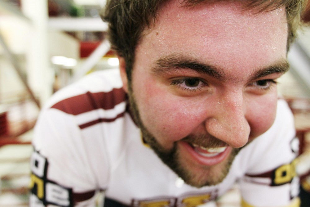 Trevor Quass, a junior studying sports management, feels the burn as sweat ran down his face on Friday at the 24-hour Ride for Research. The fundraiser, held at the Recreation Center, raised $2,920 for cancer research.