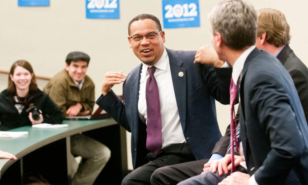 Congressman Keith Ellison, left, jokes with Mayor Rybak during a speech Wednesday in the Carlson building.  The event brought together Ellison, Rybak, and Jim Messina, President Obama's national campaign manager, to speak about the importance of University student support in his re-election bid.