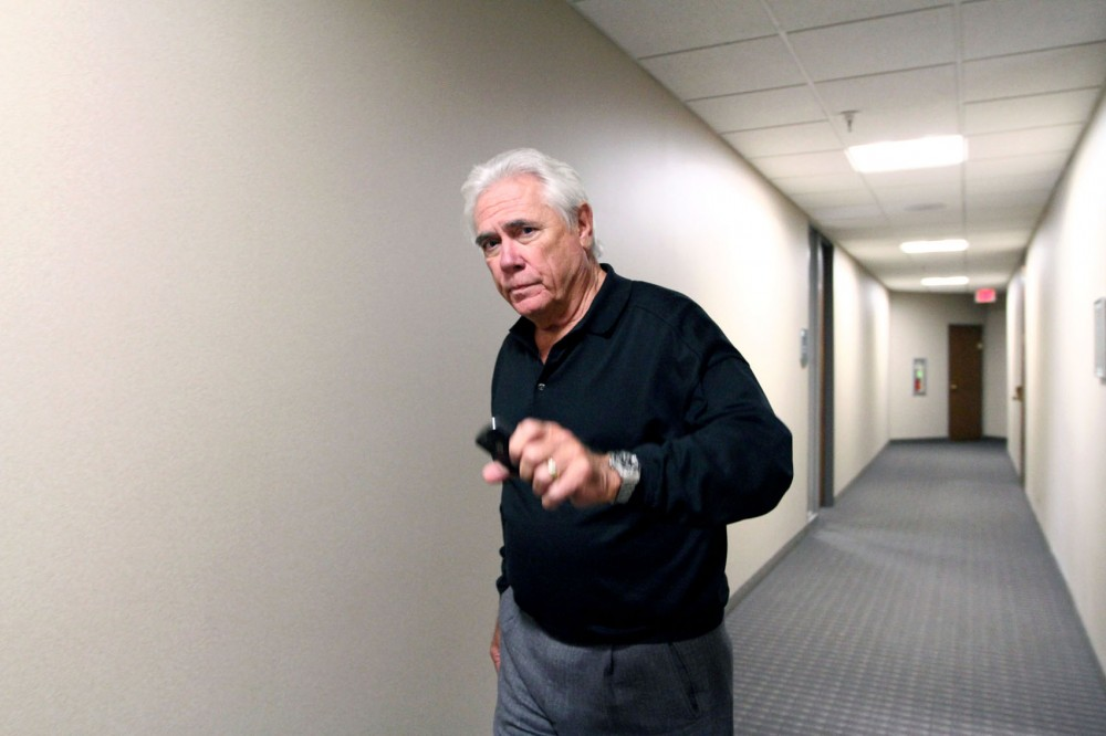 Mike Mulligan, local Jimmy John's franchise owner and president of Miklin Enterprises, leaves the National Labor Relations Board hearing room Wednesday morning. Jimmy John's management is under investigation for violating fair labor laws.