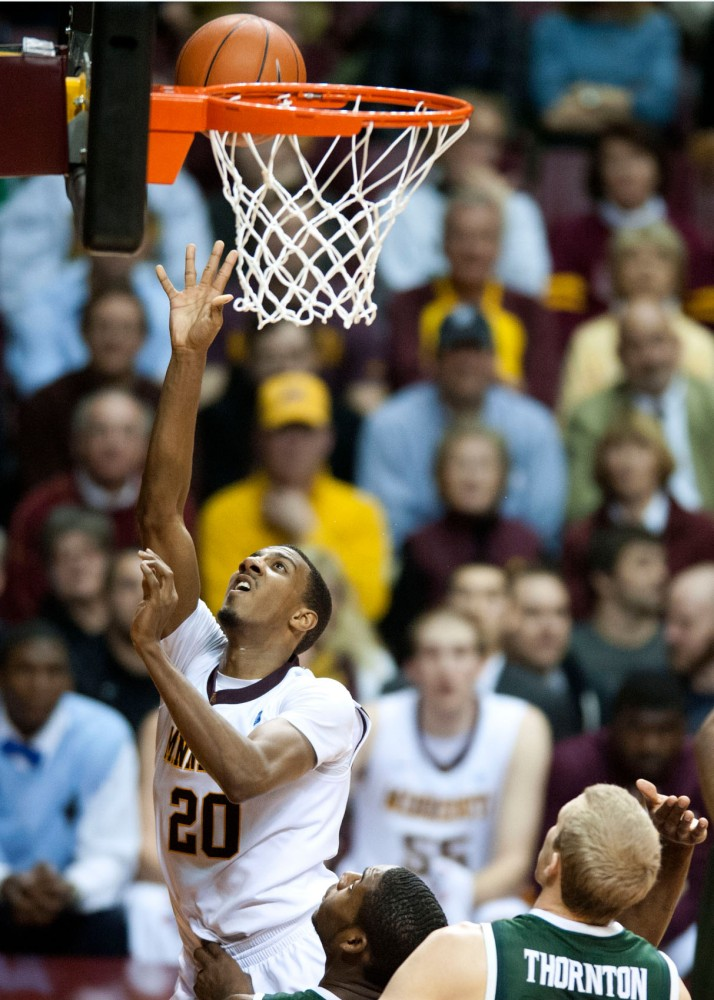 Gophers' guard Austin Hollins scores a layup during a game against Michigan State on Wednesday at William Arena.